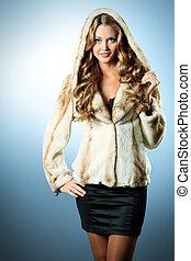 fur coat - Beautiful glamorous woman in fur coat posing at...