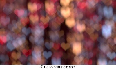 Beautiful glamour bokeh in shades of red, yellow and blue shaped heart