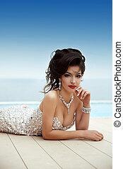 Beautiful glamour brunette gorgeous woman model in elegant fashion dress