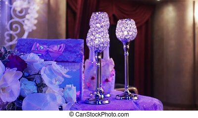 Beautiful glasses with candles