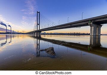 Beautiful glowing bridge over the river