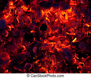 embers - beautiful glowing embers of wood on a black...