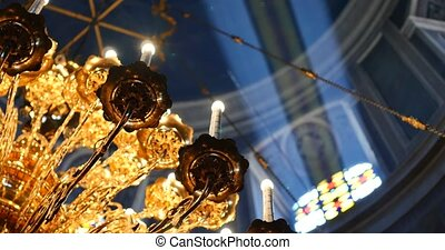 Beautiful gold Chandelier in church