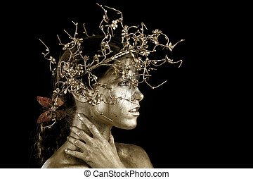 Beautiful Gold Painted Woman in Conceptual Beauty Themed...