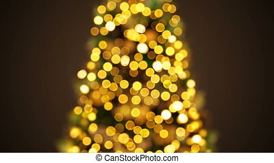 Beautiful Golden New Year Tree Lights Blinking in Defocused Blur Bokeh. Greeting Background Seamless 3d Animation. Merry Christmas and Happy New Year Celebration Concept. 4k Ultra HD 3840x2160