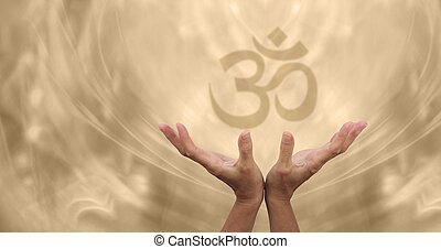 Female healing hands reaching up towards a soft focus Om symbol on a pale golden energy formation background