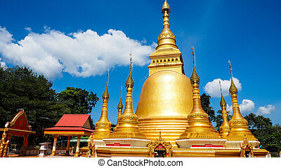 Beautiful golden pagoda in the sunny day