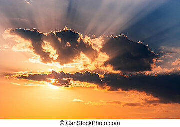beautiful Golden sunset in the sky with sun rays through the clouds