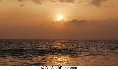 beautiful golden sunset over the Indian Ocean - view of the...