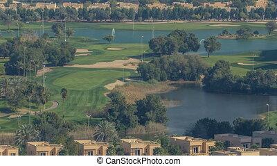Beautiful golf course near modern skyscrapers of Dubai...