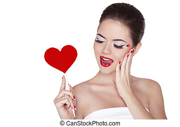 Beautiful gorgeous woman with glamour bright makeup holding red heart isolated on white background. Manicured nails and Red Lips.