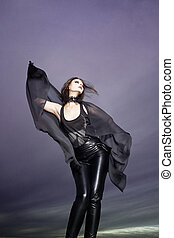 Beautiful gothic woman - Beautiful woman in front of cloud...