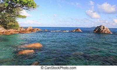 Beautiful granite boulders in Indian Ocean on the beach of Anse Lazio.