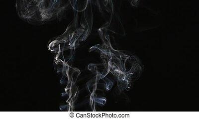 Beautiful gray smoke on a black background. Cigarette smoke. Smoke from the hookah. Turbulence of smoke. The white vapor rises. The smoke slowly flies.