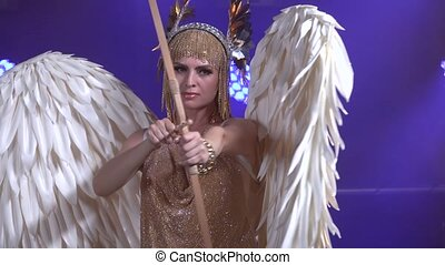 Beautiful Greek Goddess Artemis with bow and arrow on stage ...