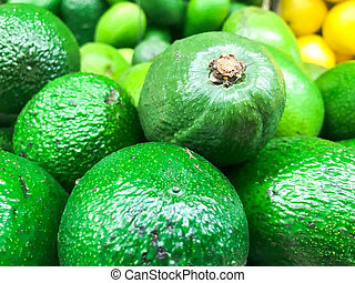 Beautiful green exotic natural sweet tasty ripe soft round big bright bright avocados. Texture, background