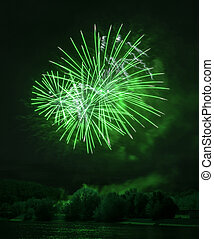 Beautiful green fireworks at night on the river in Moscow