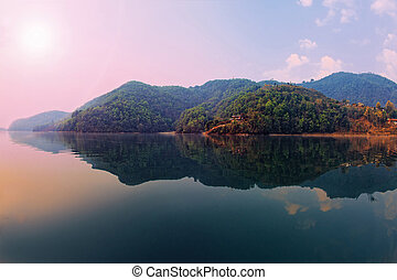 Beautiful green hills landscape from boat view on Phewa...
