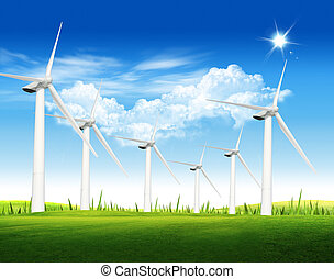 Beautiful green meadow with Wind turbines blue sky