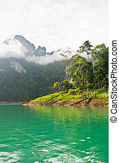 Beautiful green river and mountains in Ratchaprapha Dam,...