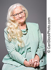 beautiful grey hair - Portrait of a modern senior woman with...