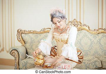 Beautiful greyhead woman in Rococo dress posing in front of...