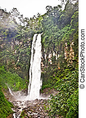 Grojogan Sewu waterfall on central Java in Indonesia. - ...