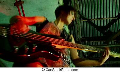 Beautiful guitar player - Beautiful girl emotionally plays...