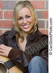 Beautiful Guitarist - A beautiful, blue eyed young woman...
