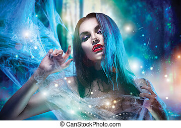 Beautiful Halloween witch portrait. Sexy model girl with Halloween makeup