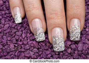 manicure - beautiful hand with fresh manicured nails
