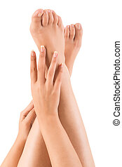 Beautiful hands on legs over white background