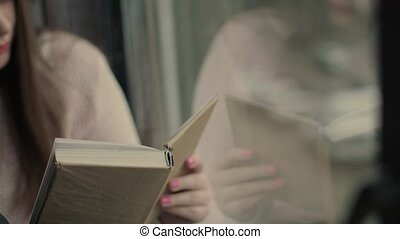 Beautiful hands young model turning pages of the book