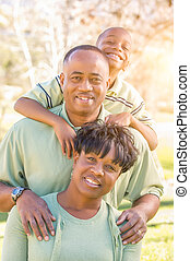 Beautiful Happy African American Family Portrait Outdoors