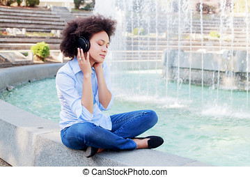 Beautiful Happy Afro American Young Woman Listening Music