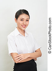 Beautiful happy asian young smiling business woman in white shirt and skirt holding