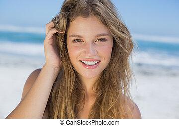 Beautiful happy blonde on the beach
