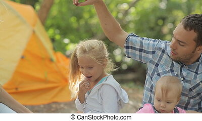 Beautiful happy family relaxing at a picnic