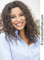 Beautiful Happy Hispanic Woman Smiling - Studio portrait of...