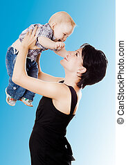 Beautiful happy mather with attractive baby boy . Portrait of  baby and his mother.