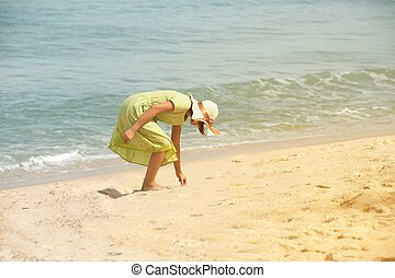 Beautiful happy multiracial Asian girl in vintage dresses walking on the beach.
