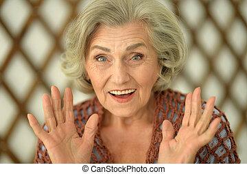 beautiful happy senior woman, close up