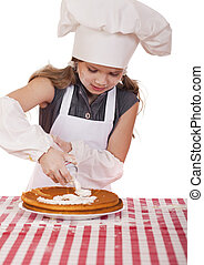 Beautiful happy seven year old girl in chef uniform with...
