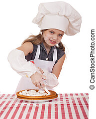 Beautiful happy seven year old girl in chef uniform with shortca