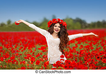 Beautiful happy smiling woman open arms in red poppy field nature background