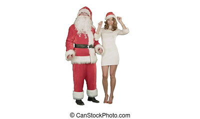 Beautiful happy woman dancing with Santa Claus on white background