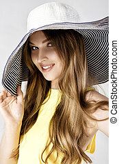 Beautiful happy woman in blue summer hat