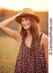Beautiful happy woman in field at sunset - Beautiful happy...