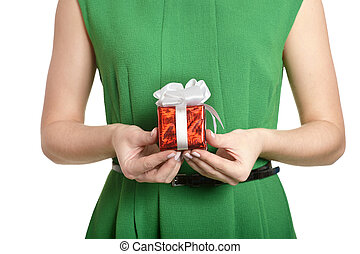 Beautiful happy woman in green dress with small gift box isolated on white background