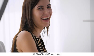 Beautiful happy woman indoors laughing